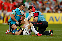 Harlequins' Mike Brown receives treatment during the Aviva Premiership match at Twickenham Stoop, London.