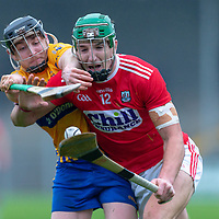 Cork's Aidan Walsh is tackled by Clare's Mickey O'Neill