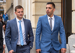 © Licensed to London News Pictures. 08/08/2018. Bristol, UK. RYAN HALE (left) and RYAN ALI (right) return to Bristol Crown court after lunch today for the third day of their trial with Ben Stokes on charges of affray that relate to a fight outside a Bristol nightclub on September 25 2017. England cricketer Ben Stokes and two other men, Ryan Ali, 28, and Ryan Hale, 27, all deny the charge. Stokes, Ali and Hale are jointly charged with affray in the Clifton Triangle area of Bristol on September 25 last year, several hours after England had played a one-day international against the West Indies in the city. A 27-year-old man allegedly suffered a fractured eye socket in the incident. Photo credit: Simon Chapman/LNP