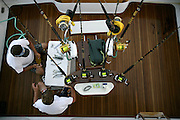 Overhead view of fighting chair and crew members prepping bait.
