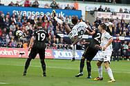 Tammy Abraham of Swansea city tries to connect with the ball as Newcastle's Javier Manquillo (19) and Mikel Merino challenge. Premier league match, Swansea city v Newcastle Utd at the Liberty Stadium in Swansea, South Wales on Sunday 10th September 2017.<br /> pic by  Andrew Orchard, Andrew Orchard sports photography.