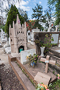 A tombstone made to look like the landmark Parroquia de San Miguel Arcangel church at Nuestra Señora de Guadalupe cemetery in San Miguel de Allende, Guanajuato, Mexico.