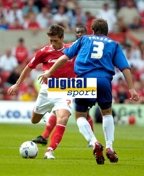 Photo: Ed Godden.<br />Nottingham Forest v Bradford City. Coca Cola League 1.<br />05/08/2006. Nicky Southall (L), takes the ball past Bradford's Ben Parker.