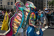Brooklyn, NY - 18 June 2016. A family of brtightly-colored seahorses with a mermaid child in the parade.