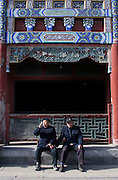 Elderly men in Liulichang Street, a popular destination for antique shopping in the heart of Beijing.