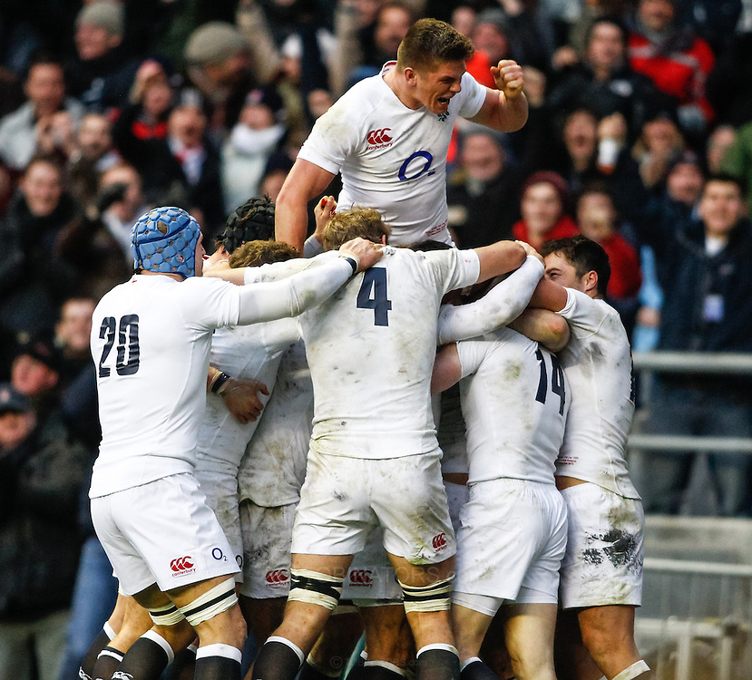 Picture by Andrew Tobin/SLIK images +44 7710 761829. 2nd December 2012. Owen Farrell of England leaps on top of the celebrating England team after Chris Ashton's try during the QBE Internationals match between England and the New Zealand All Blacks at Twickenham Stadium, London, England. England won the game 38-21.