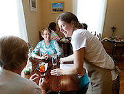 Owner Jane Muscroft (right) serves drinks to Carmen Littleton of Dorsey (left) and Pam Meyer (center) of Godfrey at Muscroft's Queen's Cuisine Tea Room in Edwardsville. Muscroft is from England and has many original recipes for patrons of her new business, which has been open about a month.