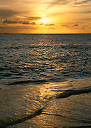 Caribbean beach at sunset with ocean and waves