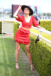 Australian Turf Club and Manning Cartell collaborate on a world-first fashion collection inspired by jockey silks. As Sydney super mare Winx aims for her 27th consecutive win and third title in the Group 1 $500,000 Colgate Optic White Stakes at Royal Randwick, supermodel Robyn Lawley was trackside taking in all the action racegoers can expect during the Australian Turf Club's 2018 Everest Carnival. Robyn showcased the first garment in the Everest Carnival Silks collection created in partnership with luxury Australian fashion house Manning Cartell. Australian Turf Club teamed up with Manning Cartell to create the bespoke collection of garments inspired by the striking patterns and bold colours of winning jockey silks. Robyn Lawley's Everest Carnival Silks dress is inspired by the pattern of Winx's winning jockey silks, with an exciting splash of Colgate's signature red. Additional garments from the Everest Carnival Silks collection will be showcased throughout Everest Carnival at De Bortoli Wines Golden Rose Day, TAB Epsom Day and Moët and Chandon Spring Champion Stakes Day. 15 Sep 2018 Pictured: Tegan Martin. Photo credit: Richard Milnes / MEGA TheMegaAgency.com +1 888 505 6342