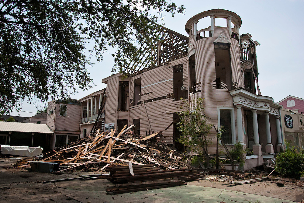 One of the Grand Dames of beautiful old buildings being demolished after suffering from Hurricane Katrina's wind damage located at 1514 St Charles Avenue at Melpomene Avenue in New Orleans, Louisiana. The owners apparently thought it was better to tear it completely down rather than attempting to restore this beautiful old building. Today, it sits as an empty lot.