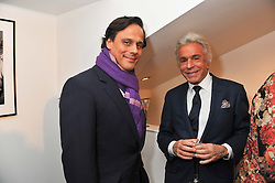 Left to right, ARUN NAYER and GIANCARLO GIAMMETTI at a private view of photographs by Anthony Souza held at The Little Black Gallery, 13A Park Walk, London SW10 on 13th December 2011.