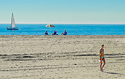 Blonde Girl in Bikini Walking on the Sand of Newport Beach