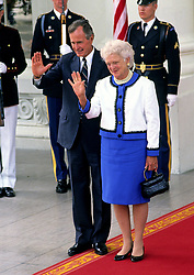 United States President George H.W. Bush, left, and first lady Barbara Bush, right, wave farewell to President Mikhail Gorbachev of the Union of Soviet Socialist Republics and his wife, Raisa, on the North Portico of the White House in Washington, DC on Sunday, June 3, 1990. The Gorbachevs were in Washington for a three day summit that included visits to Wellesley, Massachusetts and Camp David, the presidential retreat near Thurmont, Maryland. Photo by Howard L. Sachs / CNP /ABACAPRESS.COM