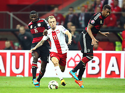 11.10.2014, National Stadium, Warsaw, POL, UEFA Euro Qualifikation, Polen vs Deutschland, Gruppe D, im Bild ANTONIO RUDIGER ( GERMANY ) KAMIL GROSICKI POLSKA JEROME BOATENG ( GERMANY ) // ANTONIO RUDIGER ( GERMANY ) KAMIL GROSICKI POLSKA JEROME BOATENG ( GERMANY ) // during the UEFA EURO 2016 Qualifier group D match between Poland and Germany at the National Stadium in Warsaw, Poland on 2014/10/11. EXPA Pictures © 2014, PhotoCredit: EXPA/ Newspix/ Michal Nowak<br /> <br /> *****ATTENTION - for AUT, SLO, CRO, SRB, BIH, MAZ, TUR, SUI, SWE only*****