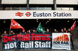 © Licensed to London News Pictures. 27/03/2013. London, UK. Rail campaigners and activists are seen at Euston station on March 27, 2013. Union leaders and rail activists stage protests at 35 stations in the UK against planned new cuts to services and staff..Photo credit : Peter Kollanyi/LNP