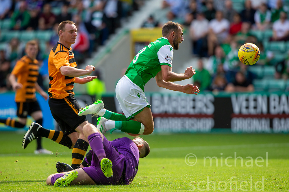 Hibernian's Christian Doidge chips Alloa Athletic's keeper Neil Parry to score their first goal but injures the keeper. Hibernian 2 v 0 Alloa Athletic, Betfred Cup game played Saturday 20th July at Easter Road, Edinburgh.