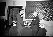 12/07/1967<br /> 07/12/1967<br /> 12 July 1967<br /> Sheaffer trophies Reception at the Central Hotel, Dublin. Picture shows Mr B.J. Fitzpatrick, managing director of B.J. Fitzpatrick and Co. Ltd., presenting the Shearer Rose Bowl for 1967 to the captain of Rosslare Golf Club, Mr Edmond Wheeler. The troops (and 10 others) were for the Sheaffer sponsored August Monday competitions at Rosslare. Winner of the 1966 competition was A.H. Morrow of the Malone Club, Belfast. The Rosslare Club had recently been extended at a cost of €12,000.