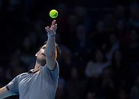Tennis - 2019 Nitto ATP Finals at The O2 - Day Seven<br /> <br /> Semi Finals: Dominic Thiem (Austria) Vs. Alexander Zverev (Germany)<br /> <br /> Dominic Thiem (Austria) serving <br /> <br /> COLORSPORT/DANIEL BEARHAM<br /> <br /> COLORSPORT/DANIEL BEARHAM