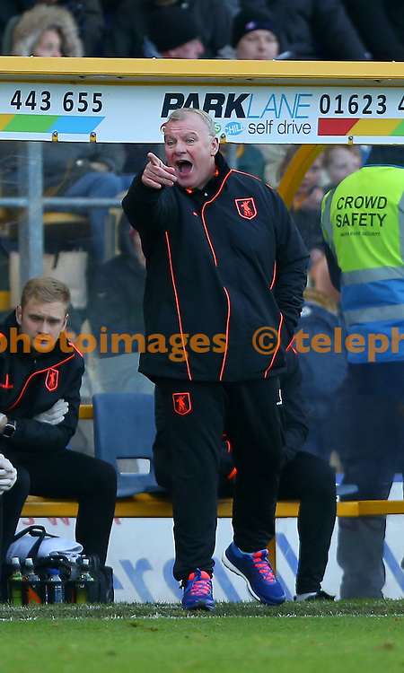 Mansfield's Manager Steve Evans gestures to his players during the Sky Bet League 2 match between Mansfield Town and Crawley Town at the One Call Stadium in Mansfield. November 19, 2016.<br /> James Boardman / Telephoto Images<br /> +44 7967 642437
