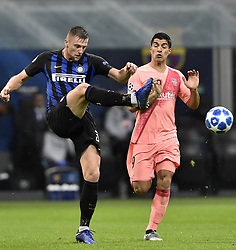 MILAN, Nov. 7, 2018  FC Barcelona's Luis Suarez (R) vies with FC Inter's Milan Skriniar during the UEFA Champions League Group B match between FC Inter and FC Barcelona in Milan, Italy, on Nov. 6, 2018. The match ended with 1-1 draw. (Credit Image: © Augusto Casasoli/Xinhua via ZUMA Wire)