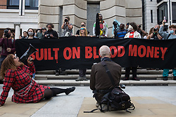 London, UK. 27th August, 2021. Environmental activists from Extinction Rebellion gather in Paternoster Square following a Blood Money March through the City of London on the fifth day of Impossible Rebellion protests. Extinction Rebellion were intending to highlight financial institutions funding fossil fuel projects, especially in the Global South, as well as law firms and institutions which facilitate them, whilst calling on the UK government to cease all new fossil fuel investment with immediate effect.