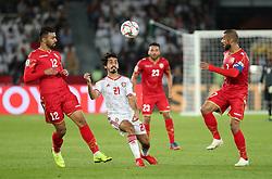 ABU DHABI, Jan. 6, 2019  Khalfan Mubarak Alshamsi (C) competes against Bahrain's Abdulwahab Ali Alsafi (R) and Ahmed Ali Juma.    during the opening match of the AFC Asian Cup UAE 2019 in Abu Dhabi, the United Arab Emirates (UAE), on Jan. 5, 2019. The match ended in a 1-1 draw. (Credit Image: © Lg/Xinhua via ZUMA Wire)