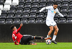 Kenji Gorre of Swansea City is tackled by Ethan Laird of Manchester United - Mandatory by-line: Craig Thomas/Replay images - 18/03/2018 - FOOTBALL - Liberty Stadium - Swansea, England - Swansea City U23 v Manchester United U23 - Premier League 2 - Divison 1