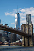 One world Trade Centre in Lower Manhattan,  looming over Brooklyn Bridge.Brooklyn, New York City, United States of America.