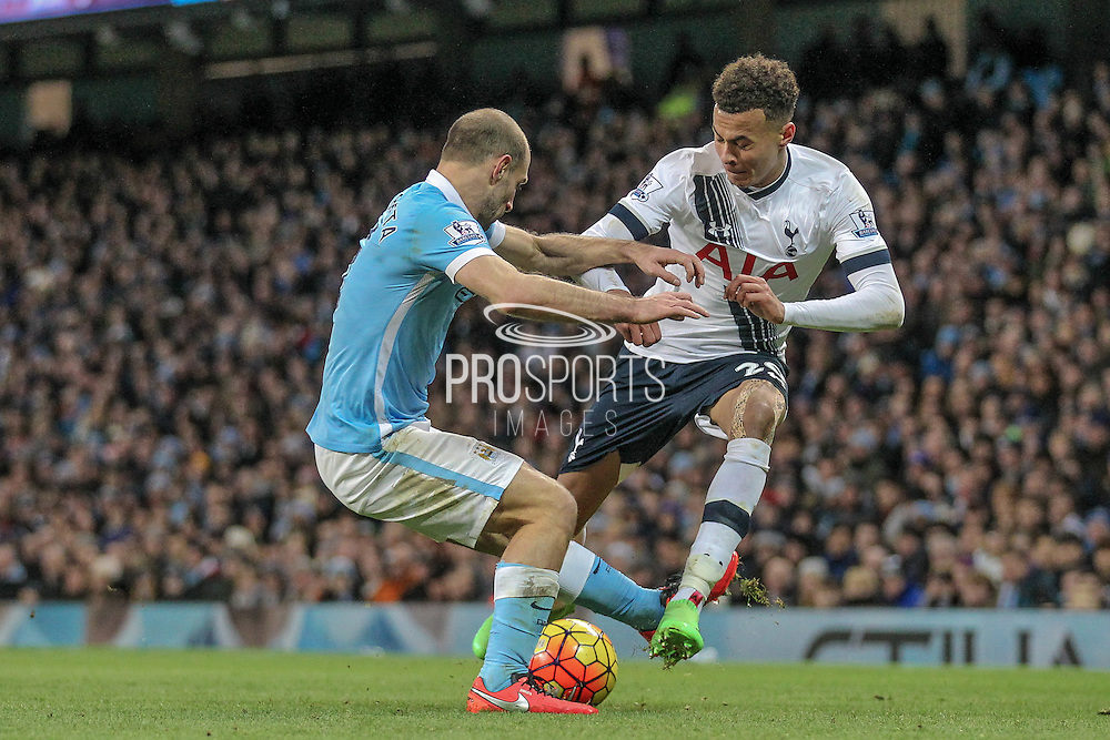 Dele Alli (Tottenham Hotspur) and Pablo Zabaleta (Manchester City) during the Barclays Premier League match between Manchester City and Tottenham Hotspur at the Etihad Stadium, Manchester, England on 14 February 2016. Photo by Mark P Doherty.