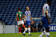 Pepe of Porto looks dejected as Rodrigo Pinho of Maritimo(L) celebrates his goal during the Portuguese League (Liga NOS) match between FC Porto and Maritimo at Estadio do Dragao, Porto, Portugal on 3 October 2020.