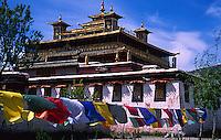 Prayer flags flutter in the breeze outside Samye monastery, Tibet.