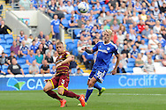 QPR's Jake Bidwell (l) clears from Cardiff City's Lex Immers. EFL Skybet championship match, Cardiff city v Queens Park Rangers at the Cardiff city stadium in Cardiff, South Wales on Sunday 14th August 2016.<br /> pic by Carl Robertson, Andrew Orchard sports photography.