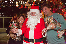 """Leah Browning, with dog """"Sugar Daisy"""" adopted two years ago from the Humane Society and Cpt. Scott Browning with Cinnamon pose for a picture with Santa.  Christmas Tree Lighting and Seasonal Fundraiser for the Humane Society of St. Thomas.  St. Thomas, USVI.  11 De© Aisha-Zakiya Boyd"""