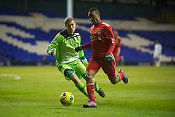 LONDON, ENGLAND - Wednesday, February 1, 2012: Liverpool's Raheem Sterling in action against Tottenham Hotspur's goalkeeper Jonathan Miles during the NextGen Series Quarter-Final match at White Hart Lane. (Pic by David Rawcliffe/Propaganda)