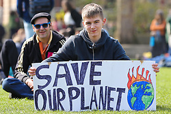 """© Licensed to London News Pictures. 15/04/2019. London, UK. A young environmental activist with a """"Save our Planet"""" demonstrates in Parliament Square to demand decisive action from the UK Government. The protest is organised by Extinction Rebellion. Photo credit: Dinendra Haria/LNP"""