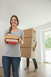 Woman happy smiling moving in new home