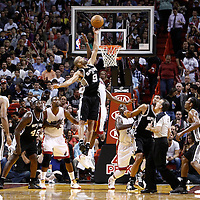 17 January 2012: San Antonio Spurs point guard Tony Parker (9) wins a jump ball against Miami Heat point guard Mario Chalmers (15) during the Miami Heat 120-98 victory over the San Antonio Spurs at the AmericanAirlines Arena, Miami, Florida, USA.