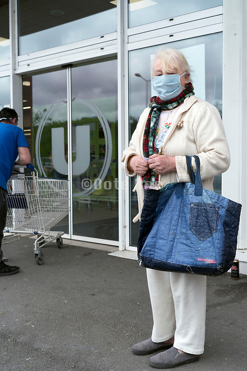 waiting in line at the supermarket during Covid 19 crisis France Limoux April 2020