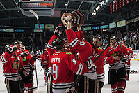 KELOWNA, CANADA - APRIL 25: Taylor Leier #20 of the Portland Winterhawks holds up the Western Conference trophy on April 25, 2014 during Game 5 of the third round of WHL Playoffs at Prospera Place in Kelowna, British Columbia, Canada. The Portland Winterhawks won 7 - 3 and took the Western Conference Championship for the fourth year in a row earning them a place in the WHL final.  (Photo by Marissa Baecker/Getty Images)  *** Local Caption *** Taylor Leier;
