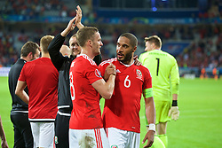 LILLE, FRANCE - Friday, July 1, 2016: Wales Andy King and captain Ashley Williams celebrate the 3-1 victory against Belgium at full time after the UEFA Euro 2016 Championship Quarter-Final match at the Stade Pierre Mauroy. (Pic by Paul Greenwood/Propaganda)