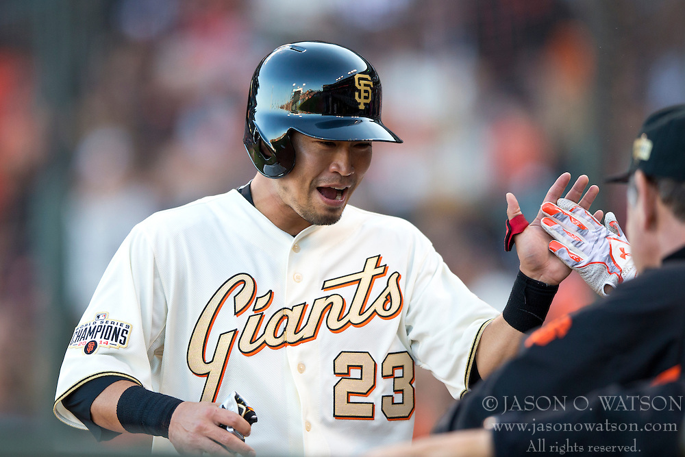 SAN FRANCISCO, CA - APRIL 18:  Nori Aoki #23 of the San Francisco Giants is congratulated by teammates after scoring a run against the Arizona Diamondbacks during the first inning at AT&T Park on April 18, 2015 in San Francisco, California.  (Photo by Jason O. Watson/Getty Images) *** Local Caption *** Nori Aoki