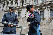 On the 100th anniversary of the Royal Air Force RAF and following a flypast of 100 aircraft formations representing Britains air defence history which flew over central London, a senior officer shows his pass to enter Horseguards, next to the memorial to those killed in the 2002 Bali bombing, on 10th July 2018, in London, England.