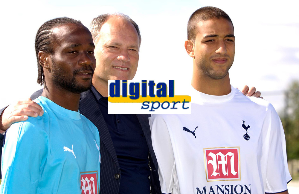 Photo: Daniel Hambury.<br />Tottenham Hotspur press conference. 07/09/2006.<br />New Spurs signings Pascal Chimbonda (L) and Mido (R) with manager Martin Jol.