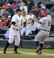 CHICAGO - JUNE 11:  Josh Fields #7 of the Chicago White Sox tags Gerald Laird #8 of the Detroit Tigers after being pulled off first base on a wide throw on June 11, 2009 at U.S. Cellular Field in Chicago, Illinois.  The White Sox defeated the Tigers 4-3.  (Photo by Ron Vesely)