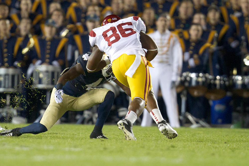 Notre Dame cornerback Gary Gray (#4) tackles USC tight end Xavier Grimble (#86) during first quarter of NCAA football game between Notre Dame and USC.  The USC Trojans defeated the Notre Dame Fighting Irish 31-17 in game at Notre Dame Stadium in South Bend, Indiana.