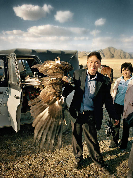 A business man and his eagle.<br /> <br /> Eagle Hunting festival in Western Mongolia, in the province of Bayan Olgii. Mongolian and Kazak eagle hunters come to compete for 2 days at this yearly gathering. Mongolia