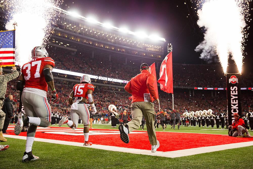 Ohio State University running back Ezekiel Elliott (15) and linebacker Joshua Perry (37) run onto the field before the start of a NCAA Division I football game between Ohio State University and the University of Minnesota at Ohio Stadium on November 7, 2015 in Columbus, Ohio. (Dustin Satloff)
