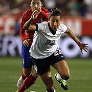 Christen Press, USA, is challenged by Lee Mina, Korea Republic, during the U.S. Women Vs Korea Republic friendly soccer match at Red Bull Arena, Harrison, New Jersey. USA. 20th June 2013. Photo Tim Clayton