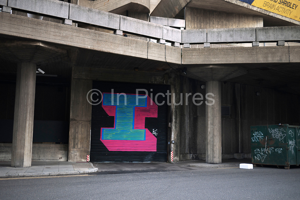 A large letter 'I' painted on some shutters to the Hayward Gallery at the Southbank, London, UK. This is street art / graffiti by artist Ben Eine, known for his letterforms.