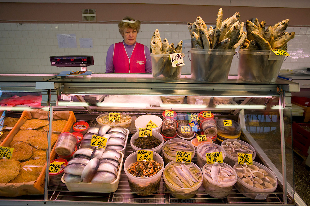 A woman sells fish and other seafood delicacies at the Central Market in Latvia's capital, Riga. (From the book What I Eat: Around the World in 80 Diets.) Established in 1201, Riga is one of Europe's largest and most ancient markets.